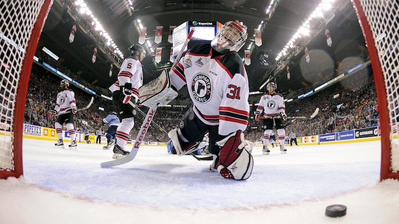 Quebec Remparts' goalie Zachary Fucale concedes a goal to the Rimouski Oceanics' during the first period of their Memorial Cup hockey game at the Colisee Pepsi in Quebec City