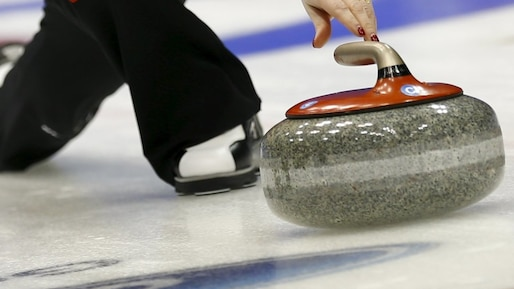 Switzerland's Lehmann delivers stone during her curling play-off session 1 vs 2 game against Switzerland at World Women's Curling Championships in Sapporo