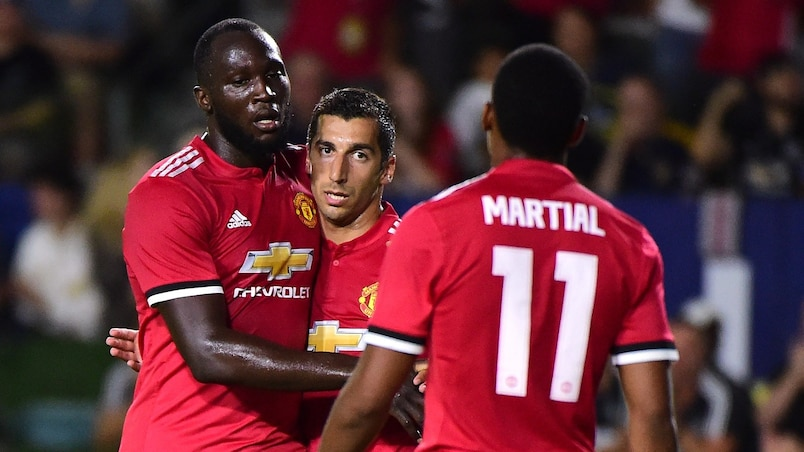CARSON, CA - JULY 15: Henrikh Mkhitaryan #22 of Manchester United celebrates his goal with Romelo Lukaku #9 and Anthony Martial #11 to take a 4-0 lead over the Los Angeles Galaxy during the second half at StubHub Center on July 15, 2017 in Carson, California. Harry How/Getty Images/AFP == FOR NEWSPAPERS, INTERNET, TELCOS & TELEVISION USE ONLY ==
