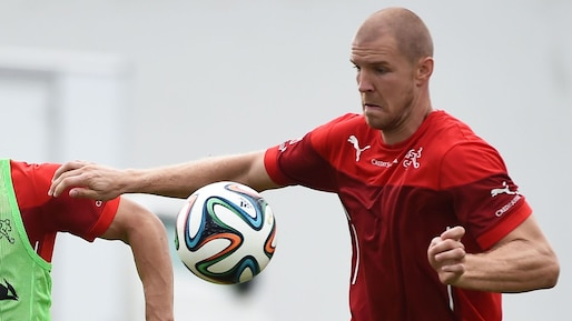 Switzerland's midfielder Xherdan Shaqiri (L) and defender Philippe Senderos vie for the ball during a training session on June 28, 2014 at the Municipal Stadium in Porto Seguro, during the 2014 FIFA World Cup football tournament in Brazil. AFP PHOTO / ANNE-CHRISTINE POUJOULAT