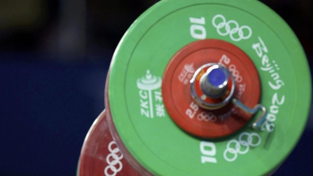 Marcin Dolega of Poland competes in the men's 105kg Group A snatch weightlifting competition at the Beijing 2008 Olympic Games