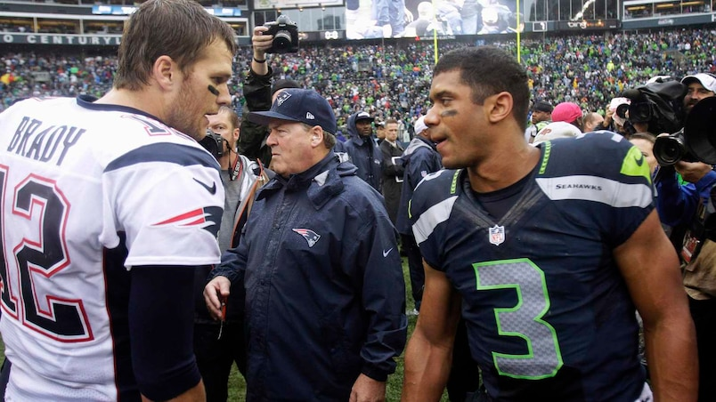 New England Patriots quarterback Tom Brady congratulates Seattle Seahawks quarterback Russell Wilson following their NFL football game in Seattle, Washington