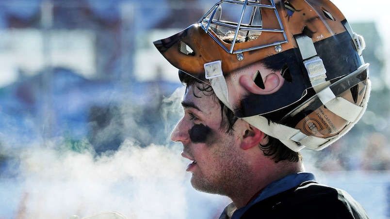 Canadiens Price talks to reporters as steam comes off his head during their team practice at the outdoor arena in McMahon Stadium in preparation for the NHL Heritage Classic hockey game in Calgary.