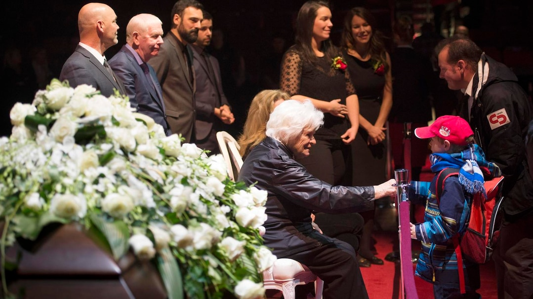 Mourners offer their condolences to Elise Beliveau wife Montreal Canadiens legend Jean Beliveau and family during the public viewing in Montreal