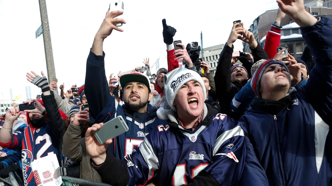 Fans cheer during the New England Patriots Super Bowl XLIX victory parade in Boston