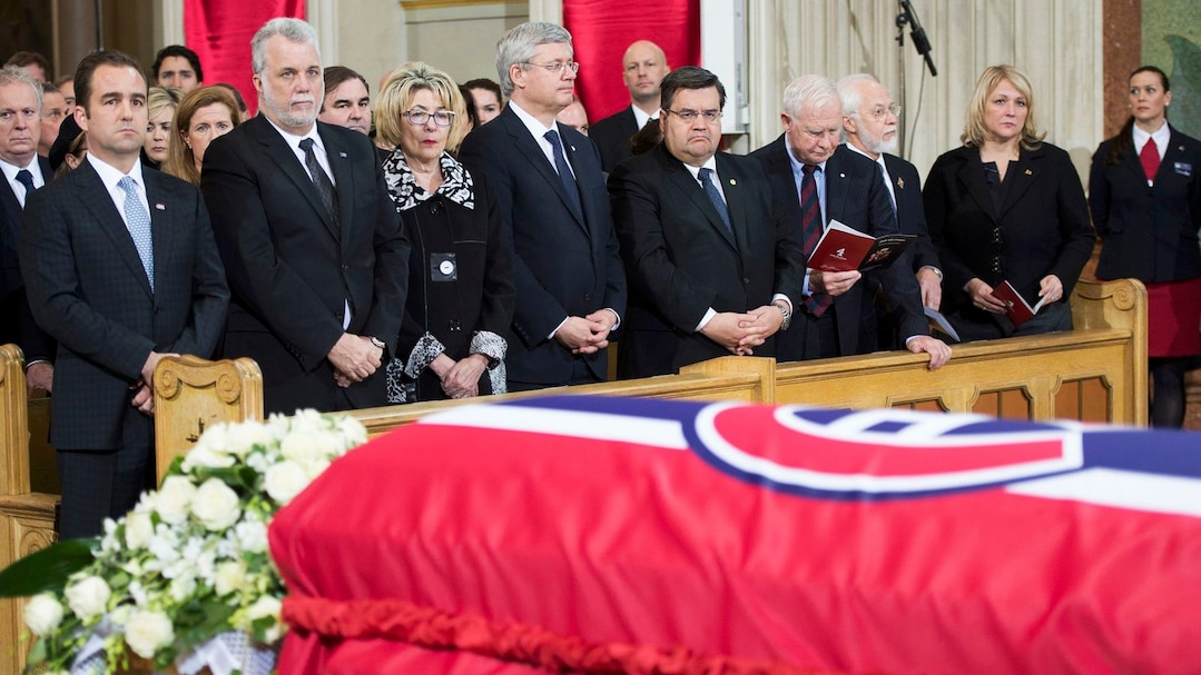 Dignitaries stand behind the casket of Jean Beliveau at the funeral for the former Montreal Canadiens captain at Mary Queen of the World Cathedral in Montreal