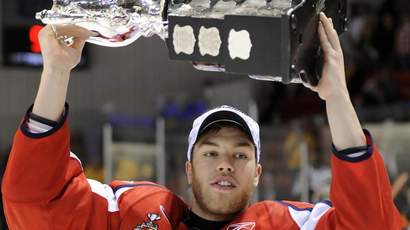 Windsor Spitfires Taylor Hall hoists the Memorial Cup after defeating the Brandon Wheat Kings in Brandon