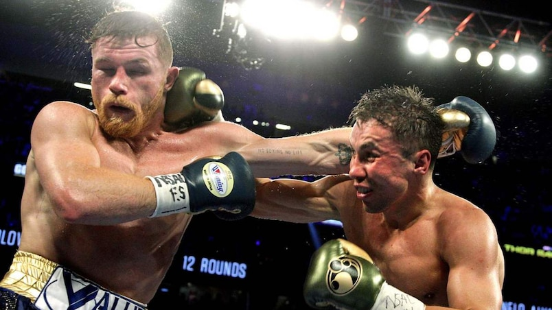 Boxing: Golovkin retains titles in thrilling draw with Alvarez