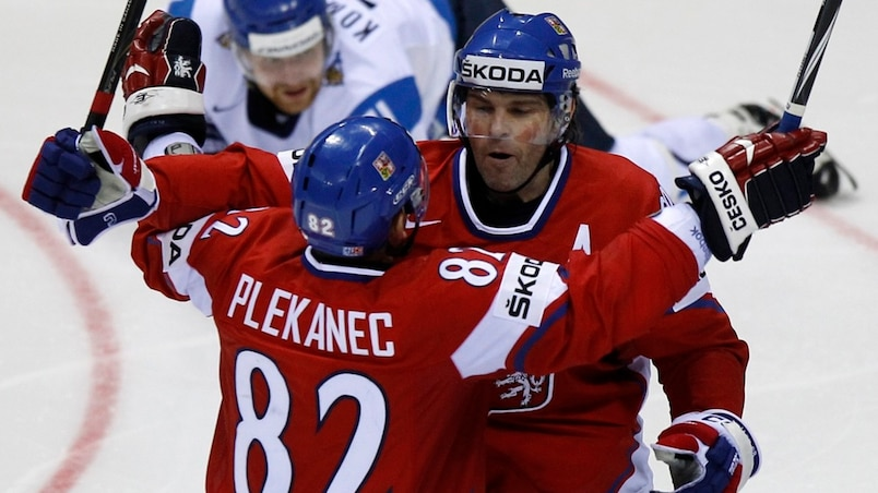Czech Republic's Jagr celebrates with teammate after scoring a goal against Finland during their preliminary round game at the Ice Hockey World Championships in Bratislava