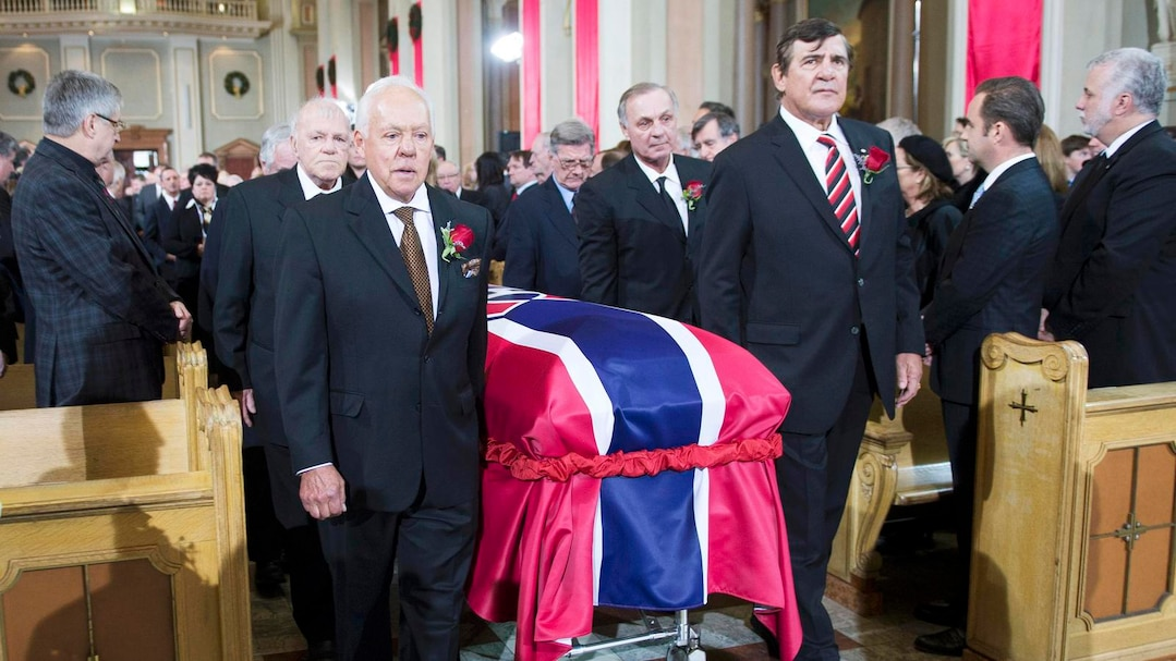 Pallbearers carry the casket of former Montreal Canadiens captain Jean Beliveau at Mary Queen of the World Cathedral in Montreal