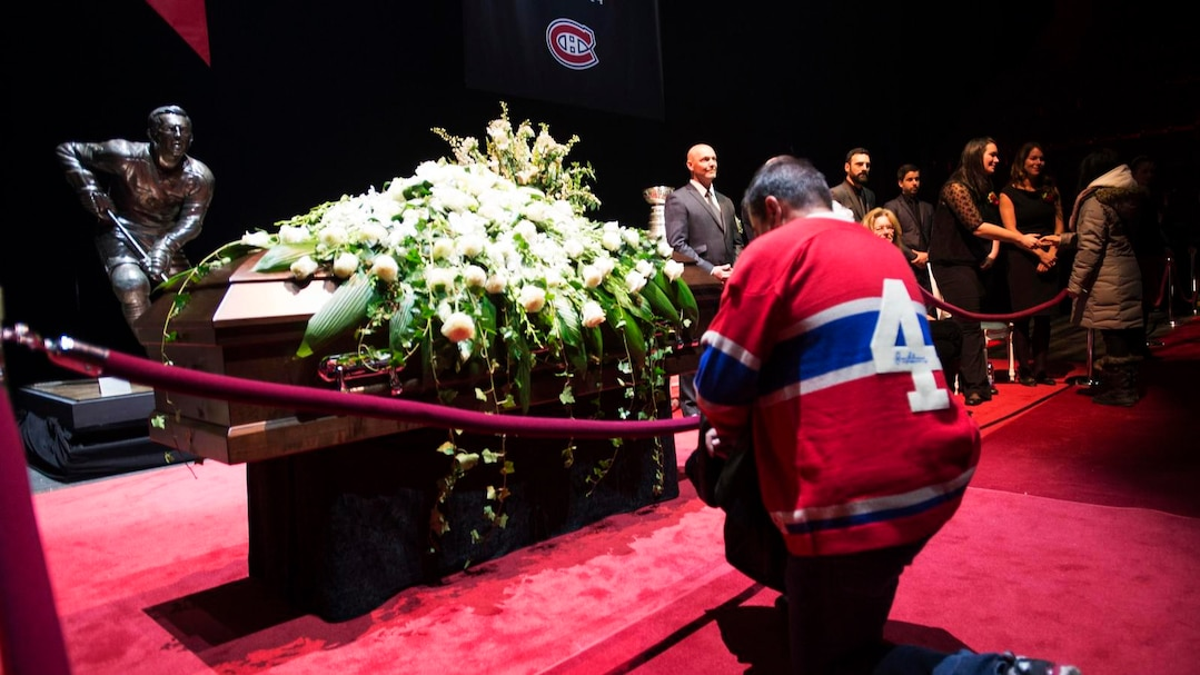 Mourners file past to pay their respect during the public viewing for the Montreal Canadiens legend Jean Beliveau in Montreal