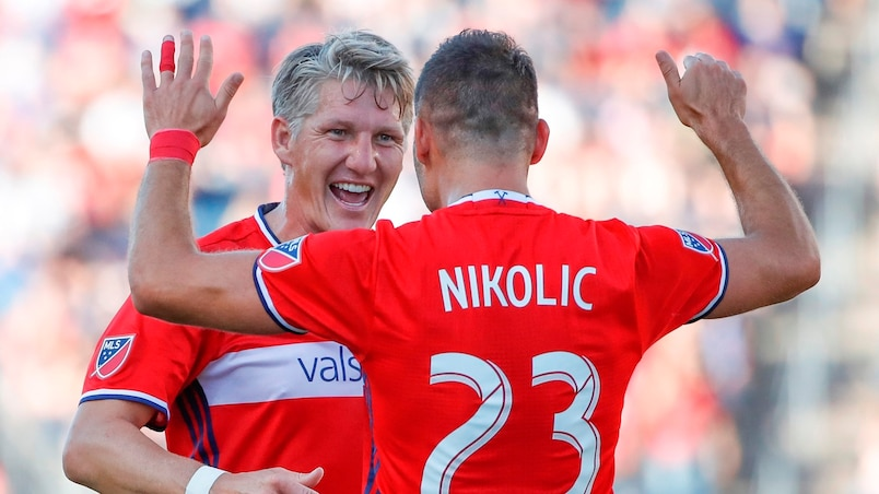 Jul 1, 2017; Chicago, IL, USA; Chicago Fire forward Nemanja Nikolic (23) celebrates with midfielder Bastian Schweinsteiger (31) after scoring against the Vancouver Whitecaps during the first half at Toyota Park. Mandatory Credit: Kamil Krzaczynski-USA TODAY Sports