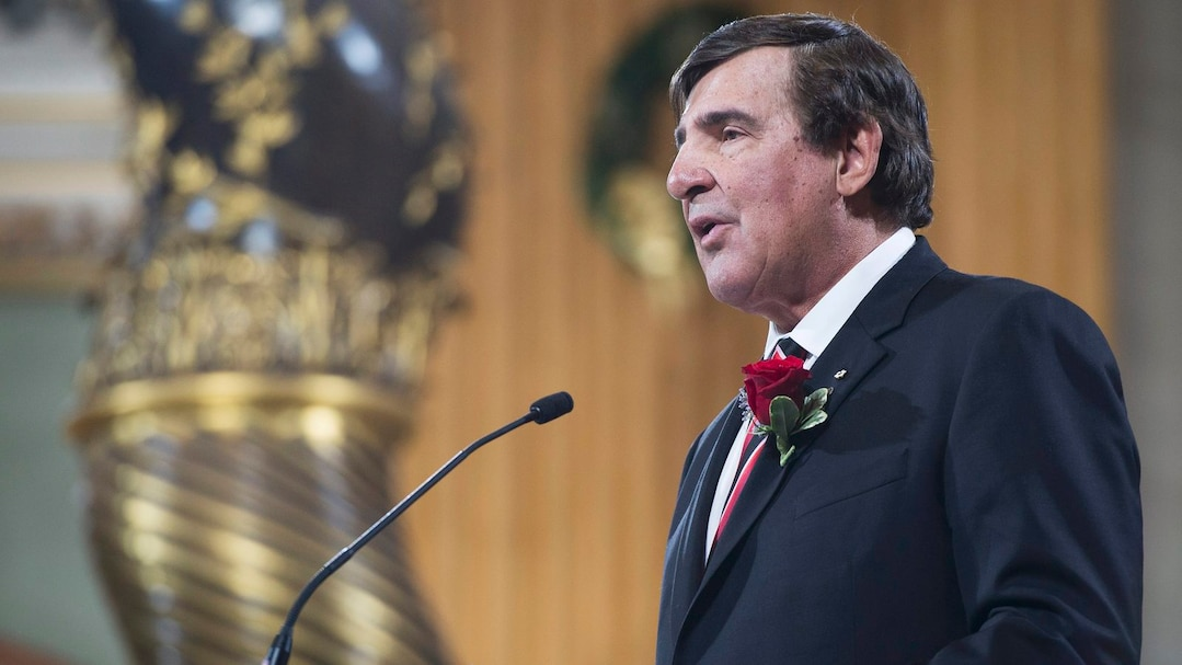 Former Montreal Canadiens teammate Serge Savard speaks at the funeral for former Montreal Canadiens captain Jean Beliveau in Montreal