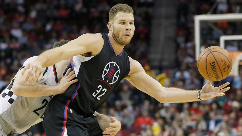 Los Angeles Clippers Blake Griffin is defended by Houston Rockets Donatas Motiejunas during their NBA game in Houston, Texas