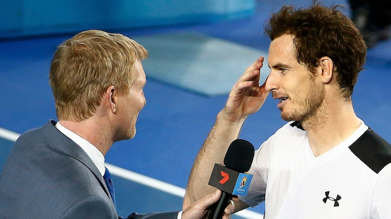 Britain's Murray speaks to former tennis player Courier after winning his semi-final match against Canada's Raonic at the Australian Open tennis tournament at Melbourne Park