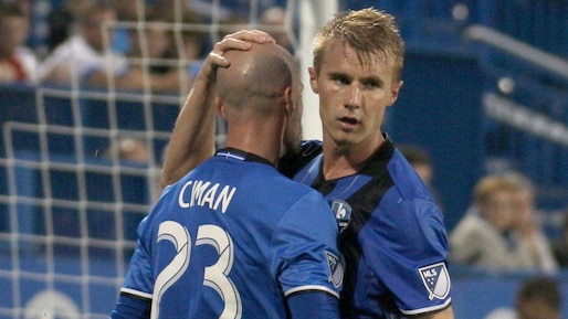 Jul 1, 2017; Montreal, Quebec, CAN; Montreal Impact defender Laurent Ciman (23) and defender Kyle Fisher (26) congratulate each other during the second half against D.C. United at the Stade Saputo. Mandatory Credit: Jean-Yves Ahern-USA TODAY Sports