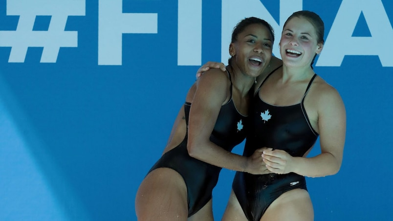 Canada's Jennifer Abel and Canada's Melissa Citrini Beaulieu react after competing in the women's 3m springboard synchro final during the diving competition at the 2017 FINA World Championships in Budapest, on July 17, 2017. / AFP PHOTO / FERENC ISZA