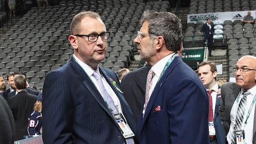 Brad Treliving discute avec Marc Bergevin.