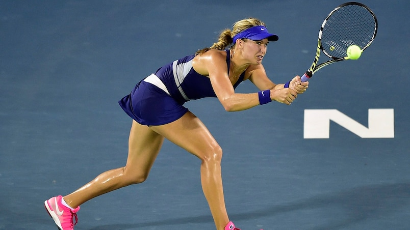 Eugenie Bouchard of Canada returns a shot to Caroline Wozniacki of Denmark during their women's singles semi-final match at the Wuhan Open Tennis Tournament in Wuhan, Hubei province
