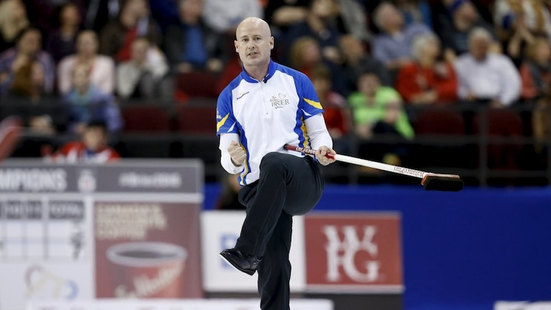 Team Alberta skip Koe reacts to his last shot against Team Newfoundland and Labrador during their gold medal game at the Brier curling championships in Ottawa