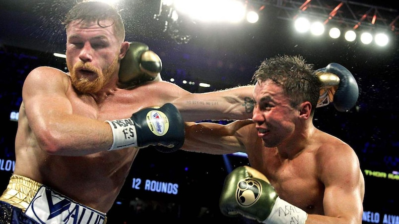 Boxing: Golovkin retains titles in thrilling draw with Alvarez