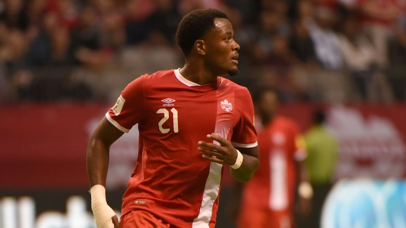 Cyle Larin of Canada runs on the field during the World Cup 2018 football qualification match between Canada and El Salvador in Vancouver on September 6, 2016. Canada won 3-1. / AFP PHOTO / Don MacKinnon