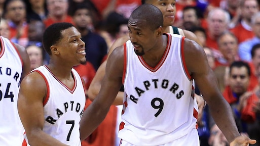 TORONTO, ON - APRIL 18: Kyle Lowry #7 of the Toronto Raptors talks with Serge Ibaka #9 in the second half of Game Two of the Eastern Conference Quarterfinals against the Milwaukee Bucks during the 2017 NBA Playoffs at Air Canada Centre on April 18, 2017 in Toronto, Canada. NOTE TO USER: User expressly acknowledges and agrees that, by downloading and or using this photograph, User is consenting to the terms and conditions of the Getty Images License Agreement. Vaughn Ridley/Getty Images/AFP == FOR NEWSPAPERS, INTERNET, TELCOS & TELEVISION USE ONLY ==