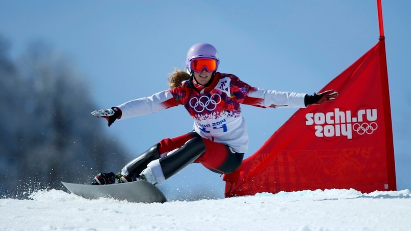 Canada's Lavigne competes during women's snowboard parallel giant slalom finals at 2014 Sochi Winter Olympic Games in Rosa Khutor