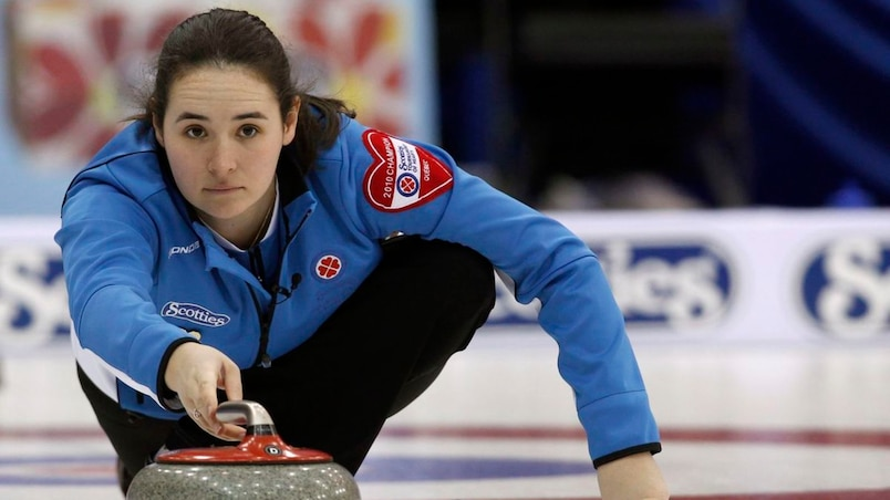 Quebec skip Belisle releases a rock during the Scotties Tournament of Hearts curling championships in Sault Ste. Marie