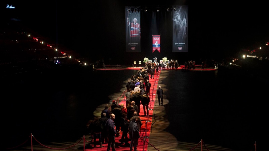 Mourners pay their respect to Montreal Canadiens legend Jean Beliveau during the public viewing in Montreal
