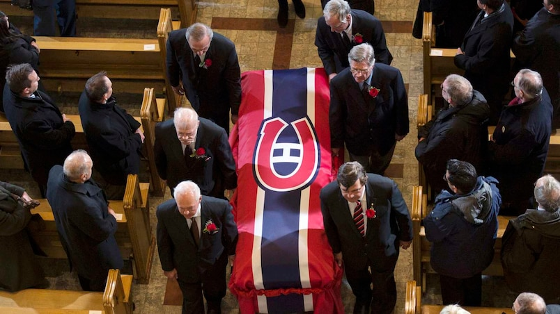 Pallbearers carry the casket after the funeral service for Montreal Canadiens legend Jean Beliveau after his funeral service in Montreal