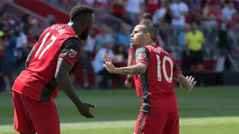 Jul 30, 2017; Toronto, Ontario, CAN; Toronto FC forward Sebastian Giovinco (10) talks with Toronto FC forward Jozy Altidore (17) in the second half during a game against New York City FC at BMO Field. Mandatory Credit: Nick Turchiaro-USA TODAY Sports